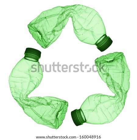 Concept of recycle.Recycle symbol made of used plastic bottles  - stock photo