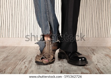 concept of rich and poor in a person - stock photo