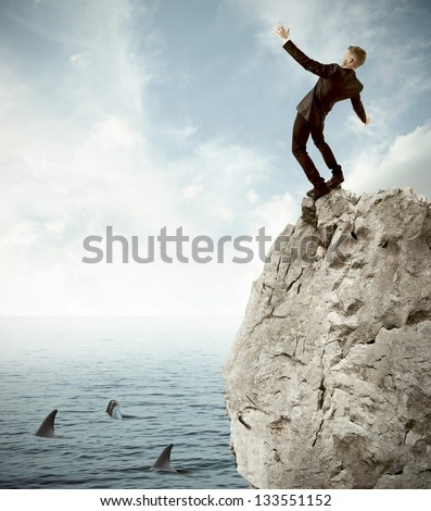 Concept of risk in business with falling businessman - stock photo