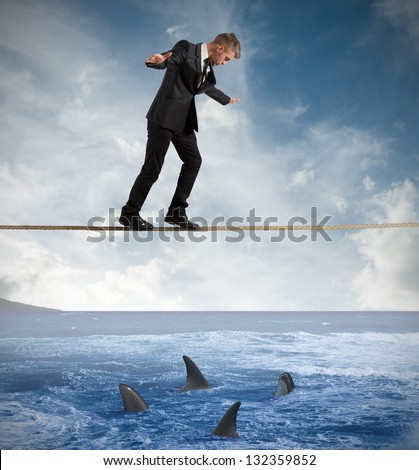 Concept of risk with businessman and shark - stock photo