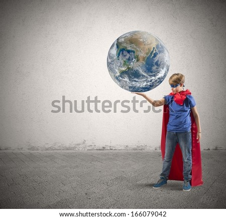 Concept of save the world with young super hero. world provided by nasa - stock photo