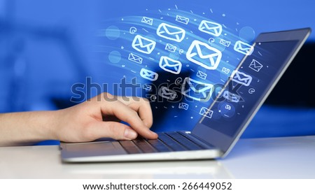 Concept of sending e-mails from your computer - stock photo