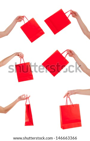Concept of shopping sale with red bags isolated on white background
