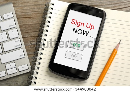 concept of sign up now with mobile phone - stock photo