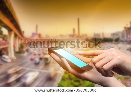 Concept of smart phone useing in city. Closed up hand of man touch screen. - stock photo