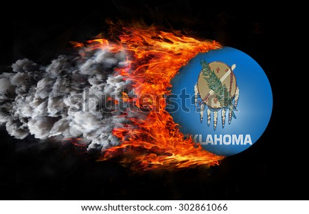 Concept of speed - Flag with a trail of fire and smoke - Oklahoma - stock photo