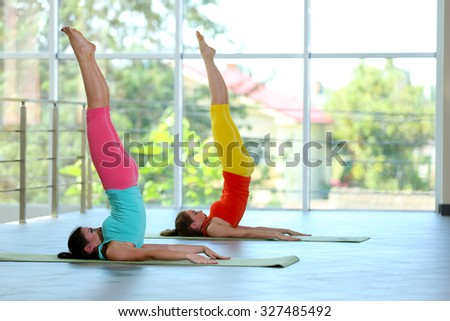 Concept of sport life - yoga, fitness, training in the class - stock photo