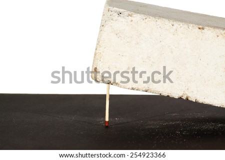Concept of stress or pressure of a match with brick - stock photo