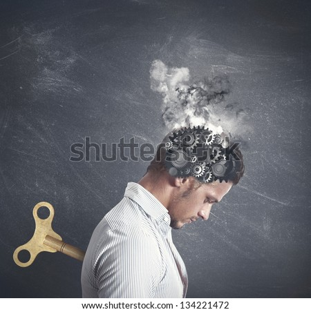 Concept of stress with gear in the head of a businessman - stock photo