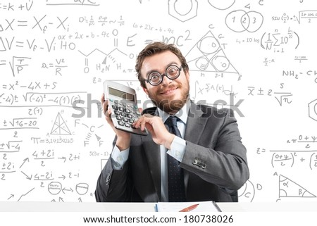 Concept of success with happy nerd businessman with calculator - stock photo