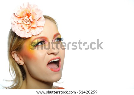 Concept of summer fashion woman with creative eye make-up in yellow and green tones screaming. copy-space