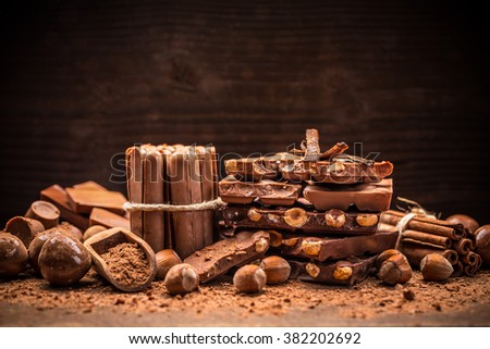 Concept of sweet milk chocolate with nuts - stock photo