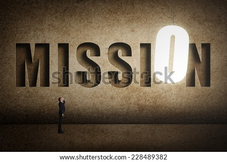 Concept of target, choice, decisioin etc with asian business man and 3D text on wall. - stock photo