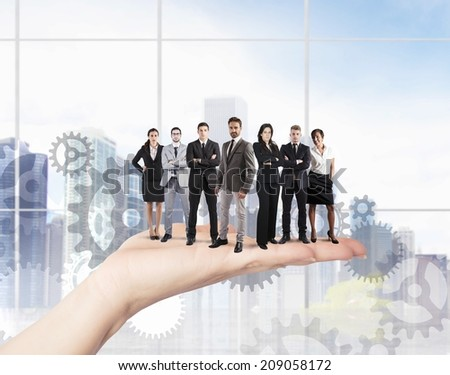 Concept of Teamwork and integration with businessperson over the hand - stock photo