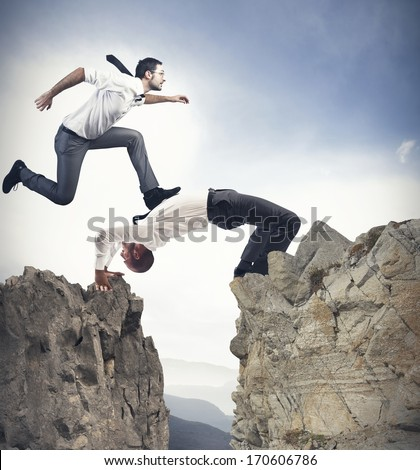 Concept of teamwork and partnership with businessman like a bridge - stock photo