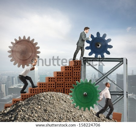 Concept of teamwork at work with gear - stock photo
