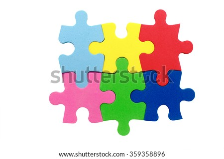 concept of teamwork. unity of six multicolored puzzle pieces symbolizes the partnership, cooperation and teamwork. Isolated on white background - stock photo