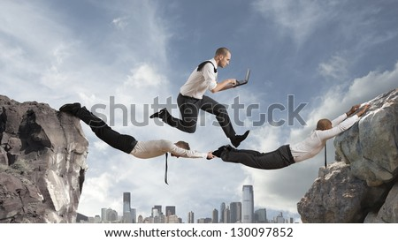 Concept of teamwork with two businessman like a bridge and a running businessmsn - stock photo