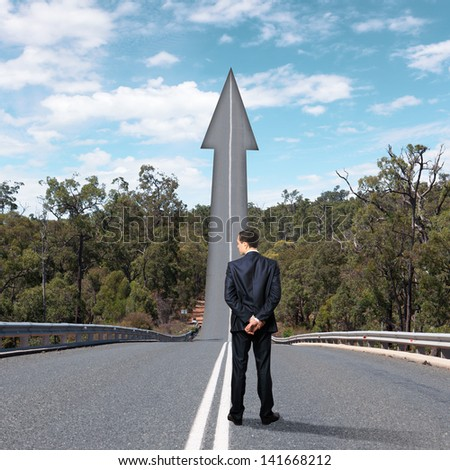 Concept of the road to success with a businessman standing on the road