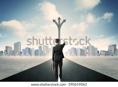 Concept of the road to success with a businessman standing on the road - stock photo