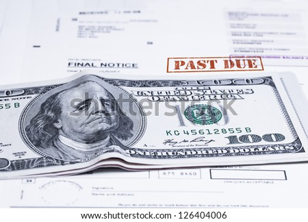 Concept of the 100 USD banknote specially bended to make Franklin's face seems upset / Upset Franklin - stock photo