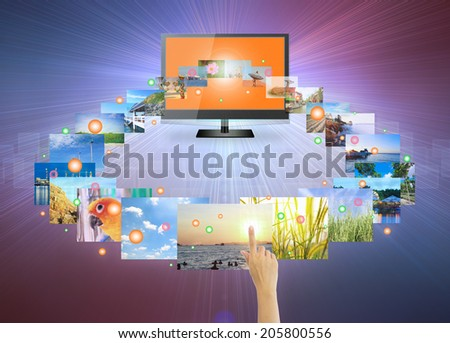Concept of touch screen tv on modern dark background. - stock photo