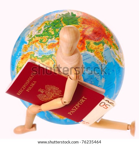 concept of traveling all over the world with wooden figure holding passport and  running around the globe isolated on white - stock photo