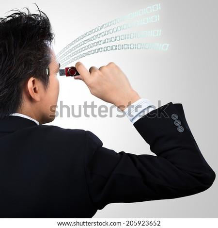 Concept of uploading data to businessman - stock photo