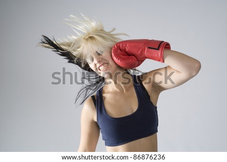 Concept of woman punching herself as self punishment