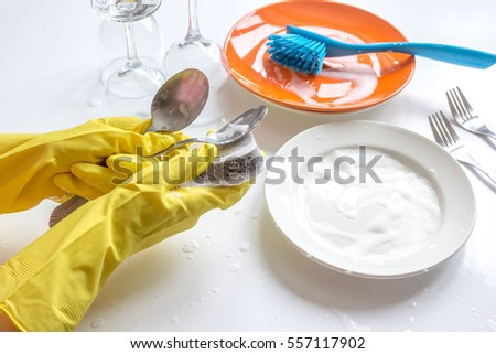 concept of woman washing dishes on white background