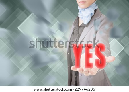 Concept of yes, business woman holding a 3d text. - stock photo