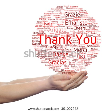 Concept or conceptual abstract thank you word cloud held in hands different language, multilingual as education or thanksgiving day - stock photo