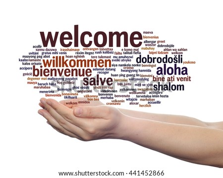Concept or conceptual abstract welcome or greeting international word cloud in hand, different languages or multilingual, metaphor to world, foreign, worldwide, travel, translate, vacation or tourism - stock photo