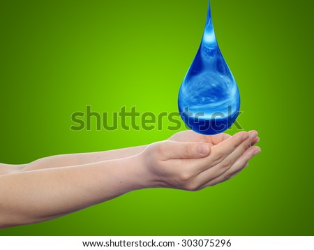 Concept or conceptual blue water or liquid drop falling in two woman hands on green gradient background for splashing, palm, clear, purity, freshness, nature, clean, health, rain, environment, drinks - stock photo