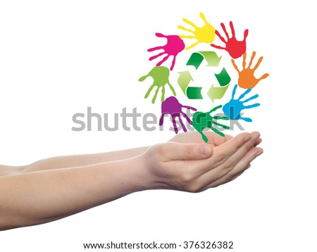 Concept or conceptual circle or spiral of colorful hand prints made by children with a green recycle symbol isolated on white background, for ecology, education, environment, eco, global nature - stock photo