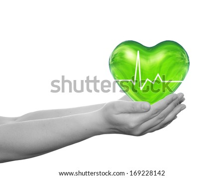 Concept or conceptual 3D green human heart sign or symbol held in human man or woman hand isolated on white background, metaphor to health, care, medicine, life, medical, pulse, healthcare cardiology - stock photo