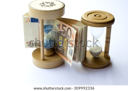Concept or conceptual euro paper money banknote with a sand glass or time background, metaphor to business, finance, loan, success, wealth, banking, economy, profit or commerce, debt, loss or vision