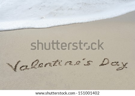 Concept or conceptual hand made or handwritten text in sand on a beach in an exotic island as metaphor to love,valentine,valentine`s,summer,spring,romantic,romance,vacation,travel,greeting or holiday