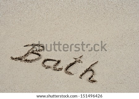 Concept or conceptual hand made or handwritten text in sand on a beach in an exotic island as metaphor to summer,ocean,sea,travel,vacation,tourism,tropical,coast,message,resort,paradise,sunny or water