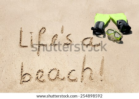 Concept or conceptual hand made or handwritten text in sand on a beach in an exotic island for summer, ocean, sea, travel, vacation, tourism, tropical, coast, message, resort, paradise, sunny or water - stock photo
