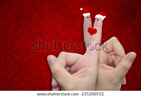 Concept or conceptual old vintage red pattern paper background with man and woman finger in love with Christmas hats and a heart painted, metaphor to family, couple, celebration, holiday, roamnce card - stock photo