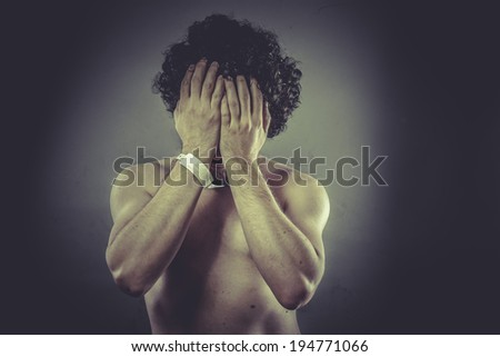 Concept pain, Nude Man with hospital bracelet. - stock photo
