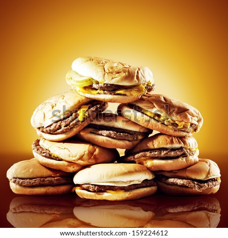 concept photo of a large pile of cheeseburgers - stock photo