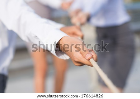 Concept photo of a leader using a rope as teamwork on the foreground  - stock photo