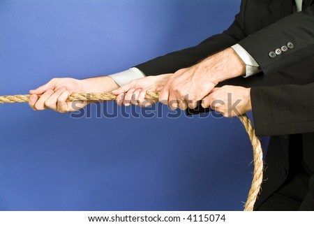concept photo of business people using a rope as teamwork. - stock photo