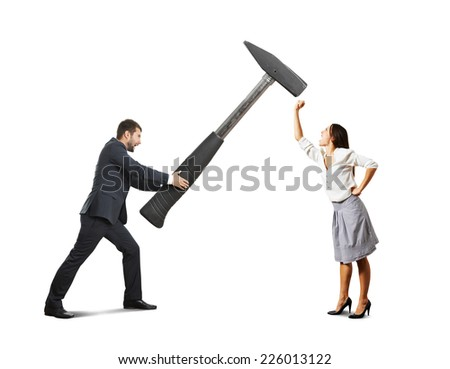 concept photo of conflict between man and woman. angry screaming man holding big hammer and hitting, woman showing fist and shouting. photo over white background - stock photo