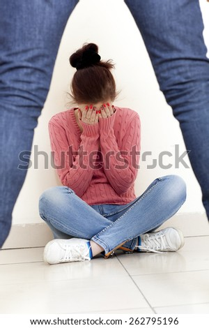 Concept photo of domestic violence. Woman in fear of domestic abuse   - stock photo