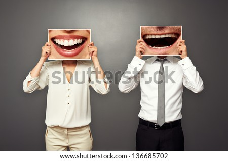 concept photo of laughing merrily couple over dark background - stock photo