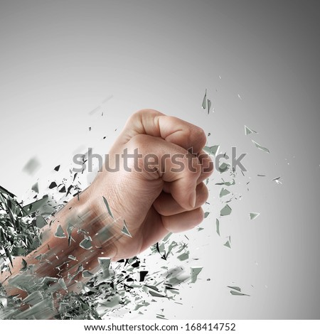 concept. power fist coming out of cracked glass High resolution  - stock photo