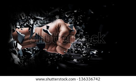 concept. power fist coming out of cracked ground isolated on black background - stock photo